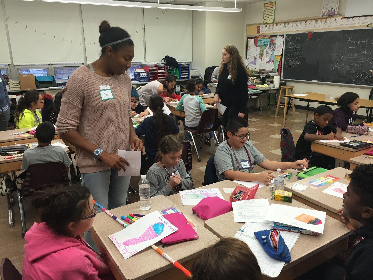 Lafayette students work with Cheston Elementary School children to help them learn about climate change.