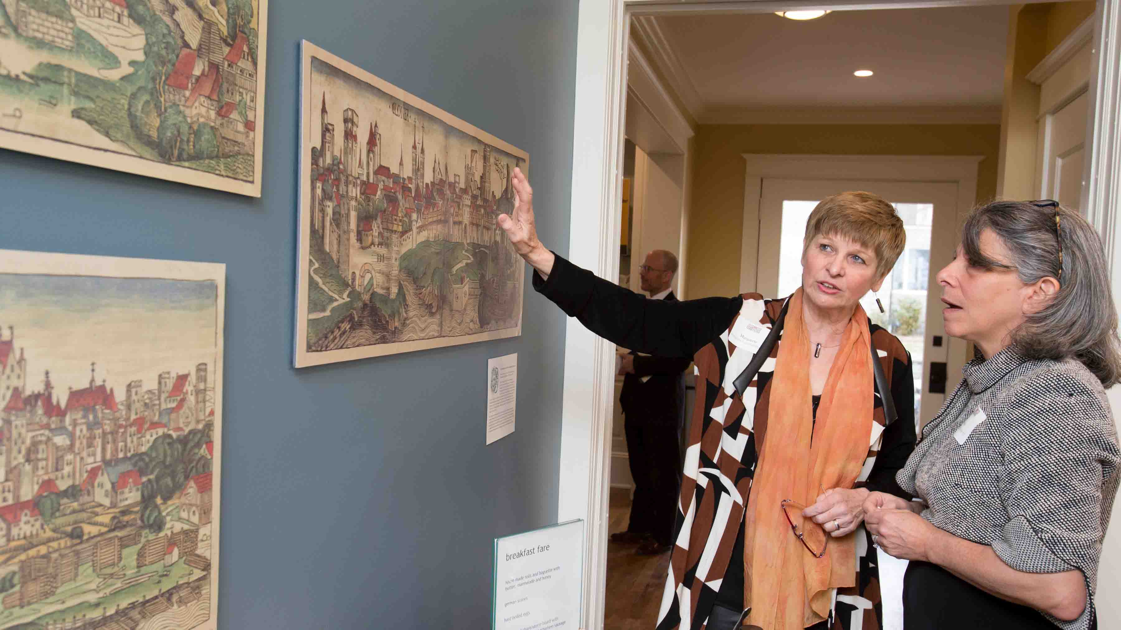 Margarete Lamb-Faffelberger and Leslie Muhlfelder look at art during the dedication of the Max Kade Center for German Studies and Visiting Scholars