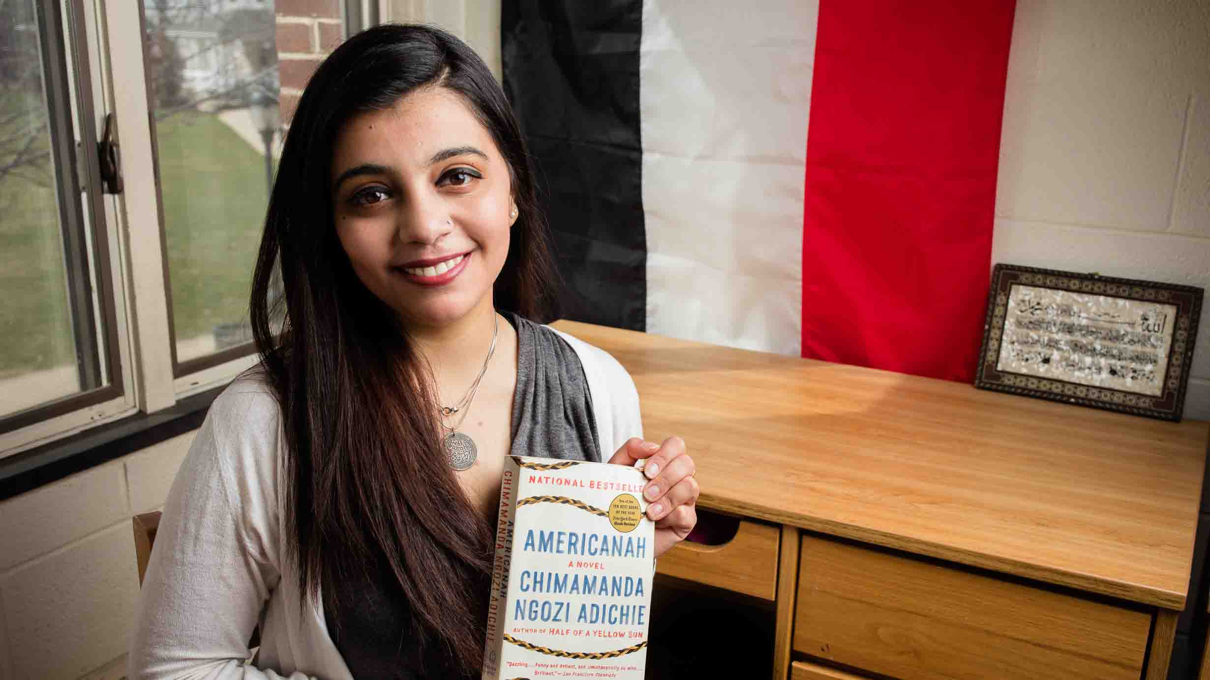 Noureen Abdelrahman '18 holds a copy of the book Americanah.