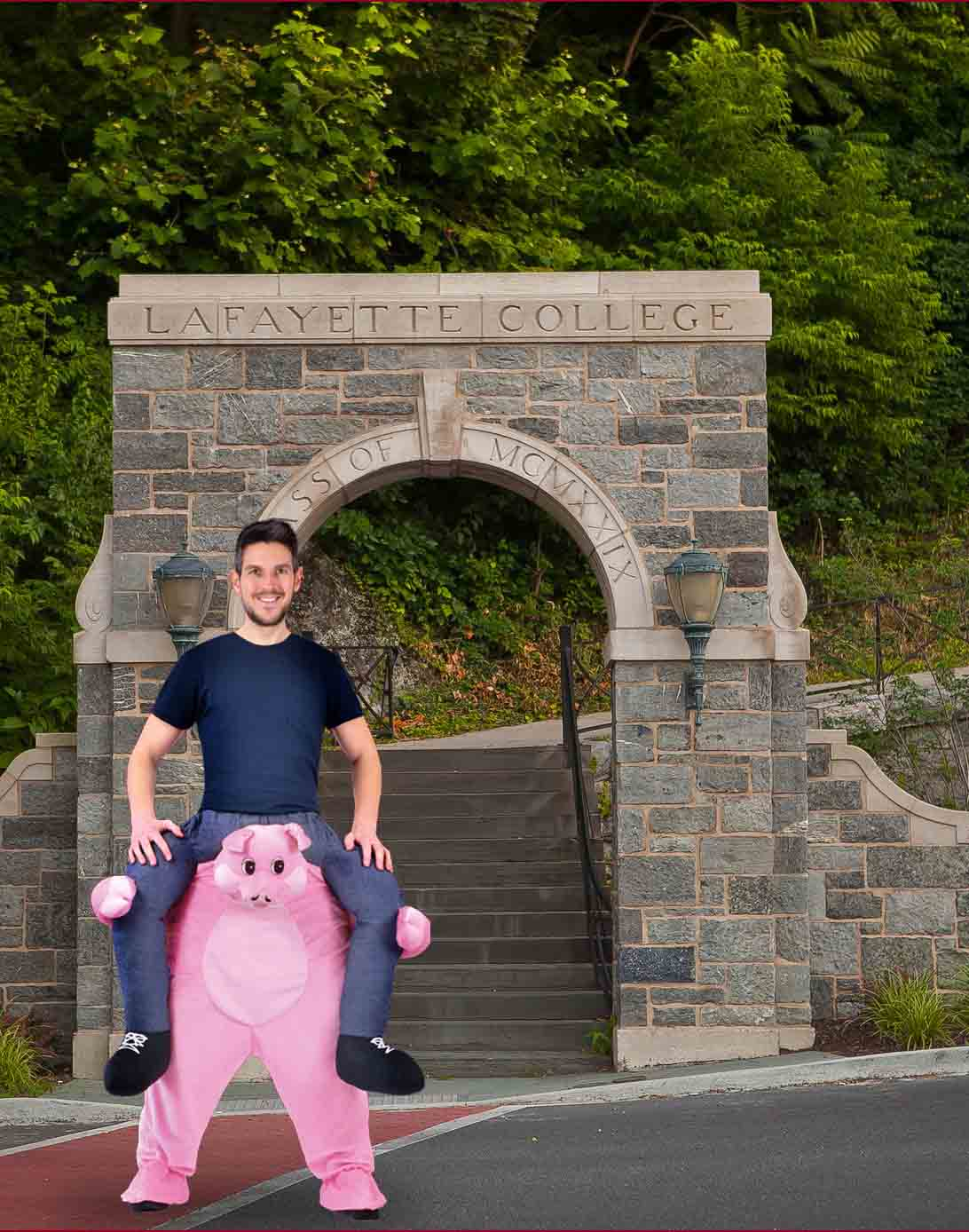 Somone in a pig costume gives a student a piggyback ride.