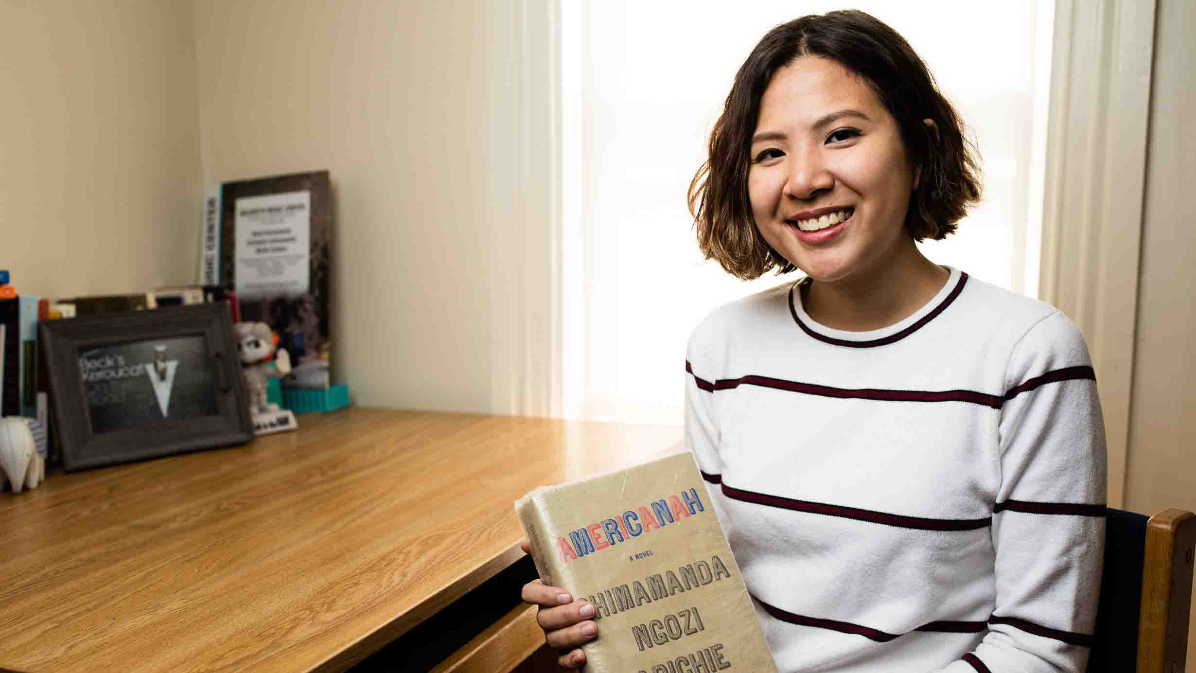 Rebecca Wai '18 holds a copy of the book Americanah.