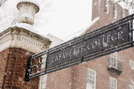 A Lafayette College sign during snowfall