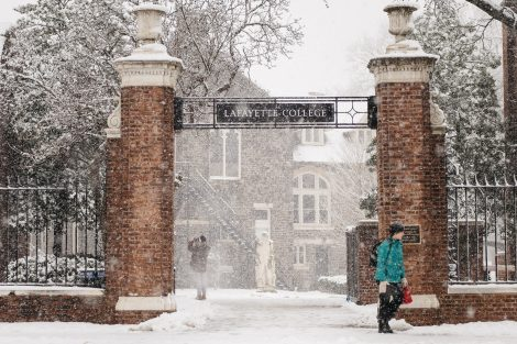 A Lafayette College gateway sign during snowfall