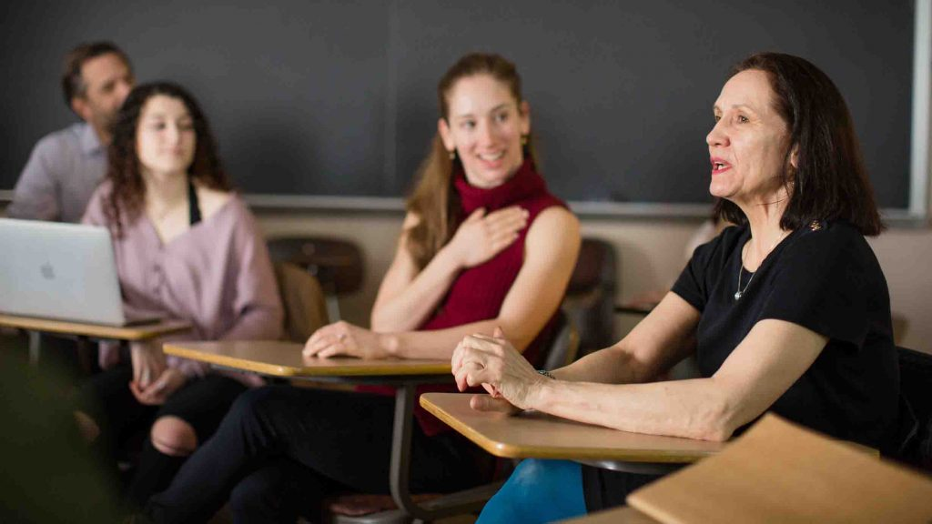 Students listen to a member of Pascal Rioult's dance troupe in class.