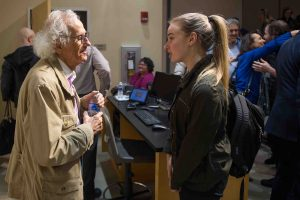 World-famous environmental artist Christo speaks with a student after giving the 2018 Grossman Visiting Artist lecture.