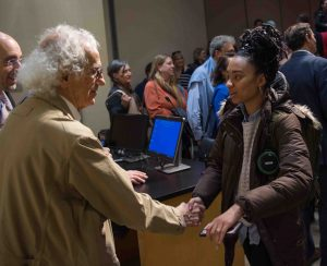 World-famous environmental artist Christo shakes hands with a student after giving the 2018 Grossman Visiting Artist lecture.