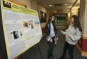 A student talks to another student in front of a poster at the LVAIC Sustainability Conference hosted by Lafayette College.