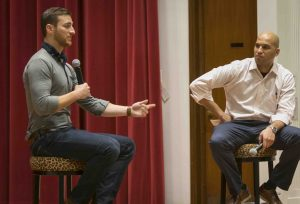 Justin Kamine '11 and Yusuf Dahl talk on stage at Colton Chapel.