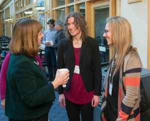 Lafayette President Alison Byerly speaks with Marie Fechik-Kirk, director of sustainability, and Kalyna Prockyk of Muhlenberg College