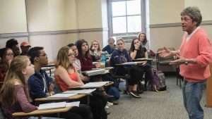 Pioneering feminist, activist and author Rita Mae Brown talks with students in class.