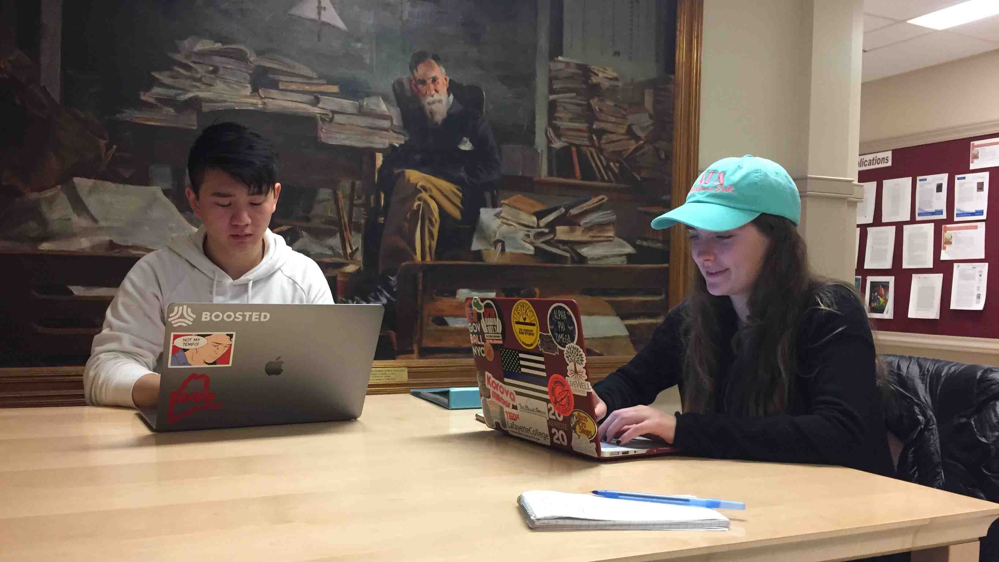 Film and media studies majors Hannah Koch '20 and Randy Zhou '20 plan in Pardee Hall by a portrait painting of Francis A. March.