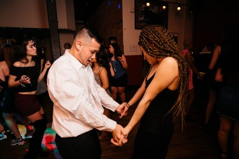 A couple dances at the Noche de Pasión semi-formal event sponsored by Hispanic Society of Lafayette.