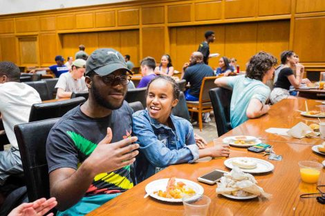 Student Charles Evans and a friend enjoy Midnight Breakfast in Marquis Hall.