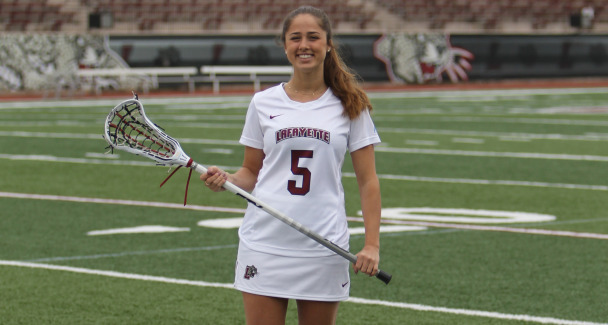 Erika Mazer '18 holds her lacrosse stick.