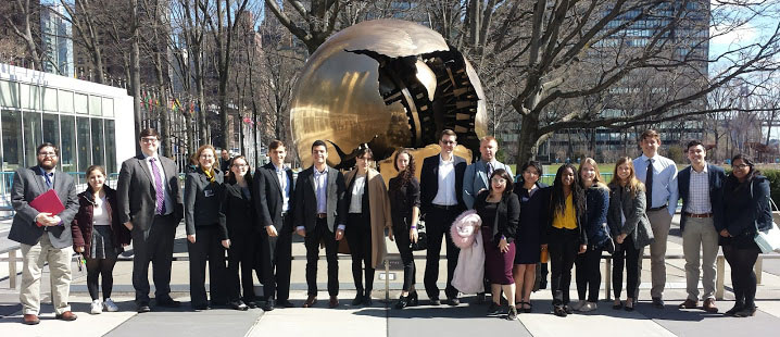 Students stand outside in the United Nations plaza in New York City.