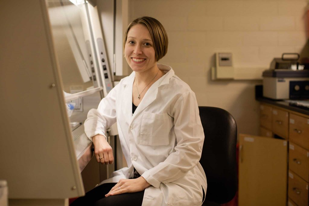 Chemical and biomolecular engineering professor Lauren Anderson wearing a lab coat