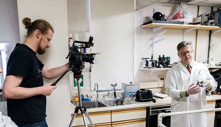 James Dearworth being filmed inlab