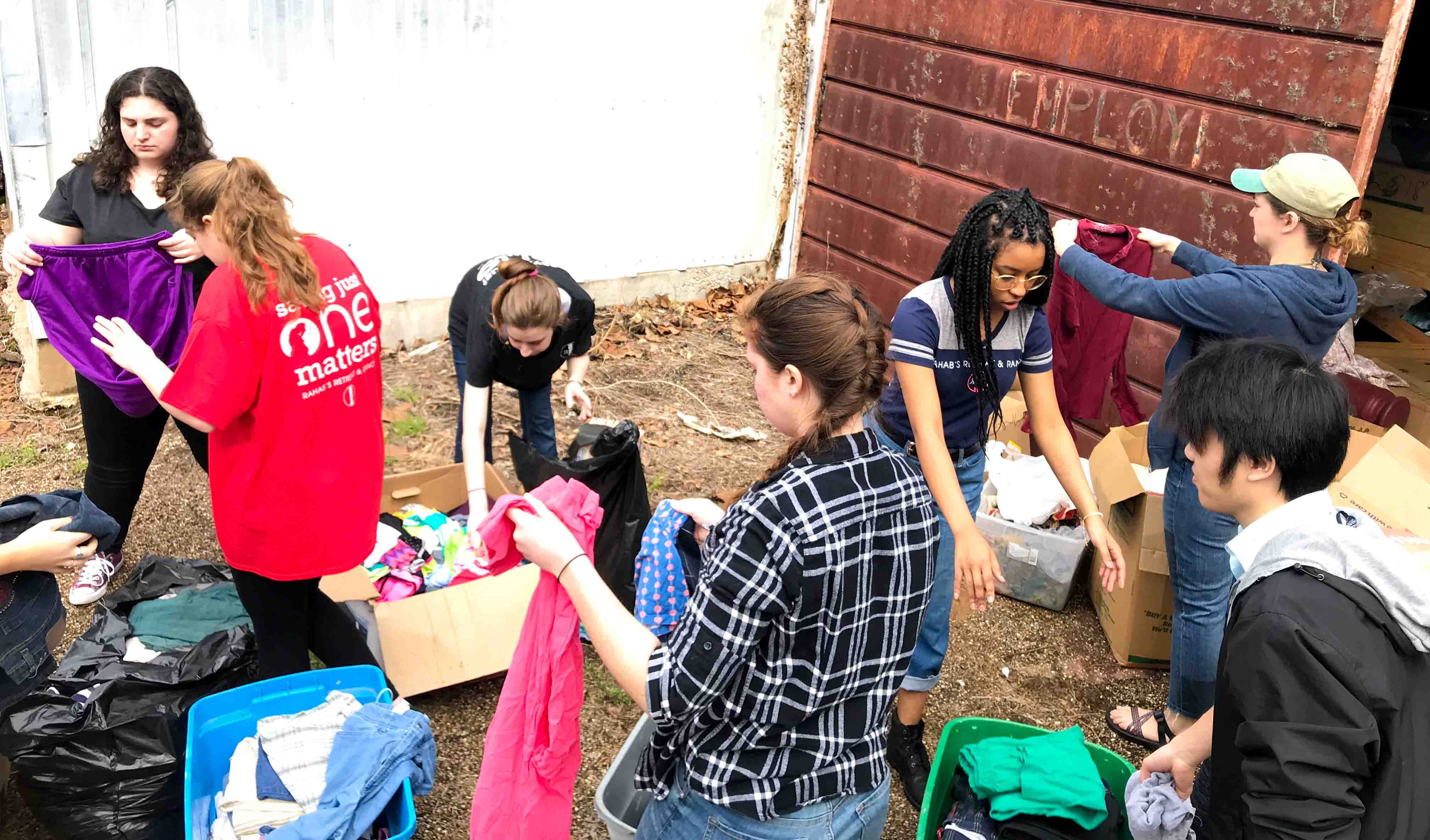 Students sort clothes during their Alternative School Break trip to serve and learn about the Texas criminal justice system.