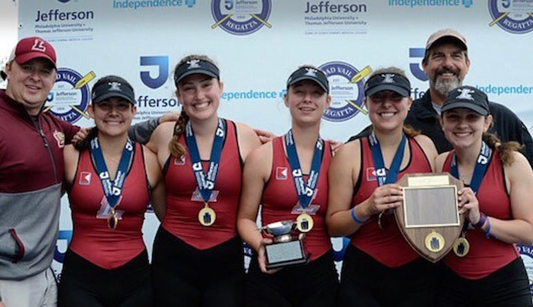 women's crew team on the podium