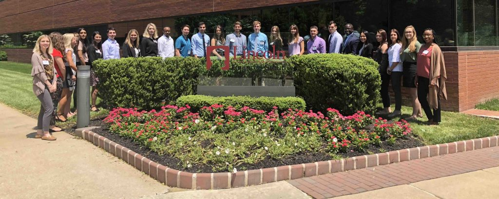 Chris Felix '18 in a group shot with fellow employees of Lincoln Financial