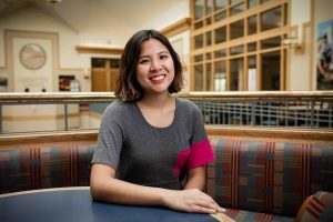 Rebecca Wai '18 sits in the Farinon Center.
