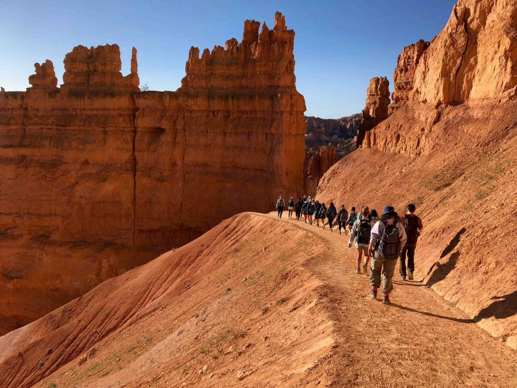Bryce Canyon National Park is home to the youngest rocks within the parks visited by students. The park is known for the uniquely shaped spires and rock fins that rise up from the edge of the plateau.