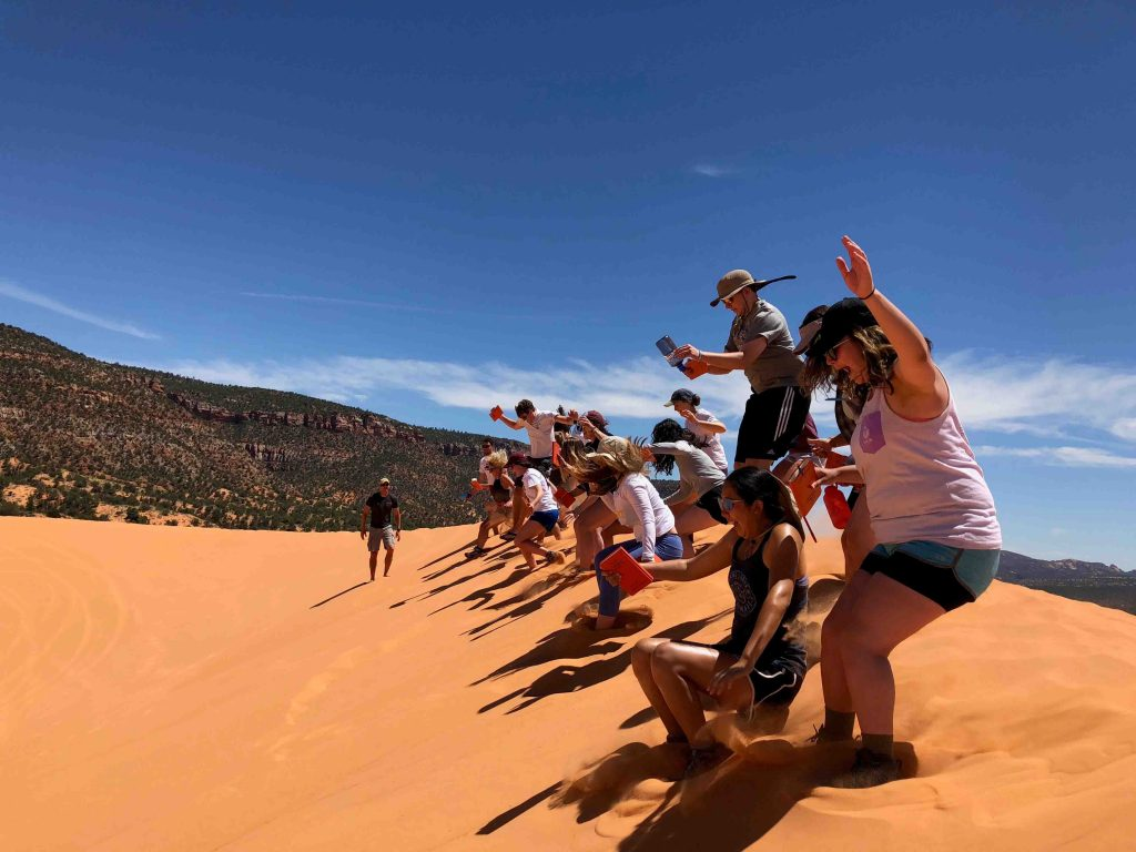 Students learn about the unique geology of Coral Pink Sand Dunes State Park in Utah, where Navajo sandstone has been transformed over time into mountains and hills of sand.