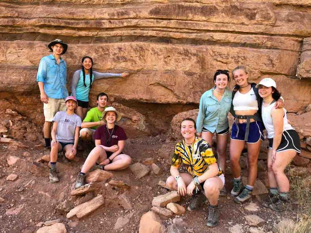Geology majors and minors together at the Great Unconformity in the Grand Canyon. This is along their 10-mile hike (5,000 feet up) from the Colorado River to the South Rim. From left: Bailey Wild '20, Annika Asplund '19, , Kat Kim '21, Griffin Williams '19, Belle Rein '20, Lucy Moeller '21, Molly Martindale '19, Amanda Willet '20, and Maddy Dragone '21