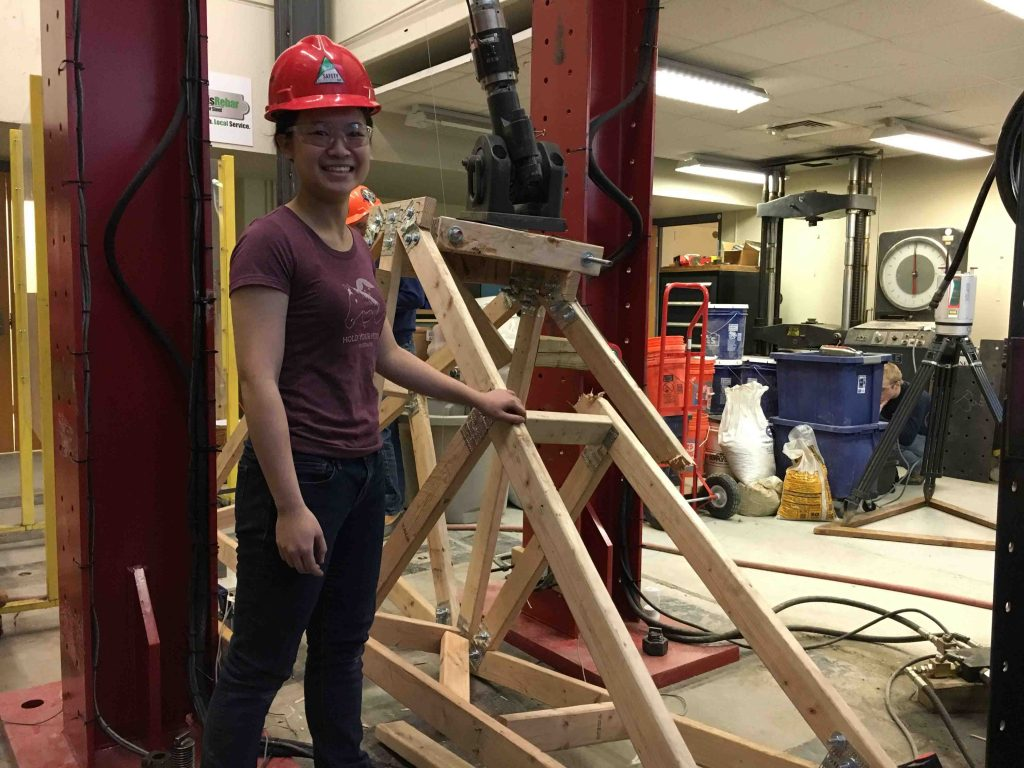 Monica Meng '18 stands by the Maroon Monster hydraulic press.