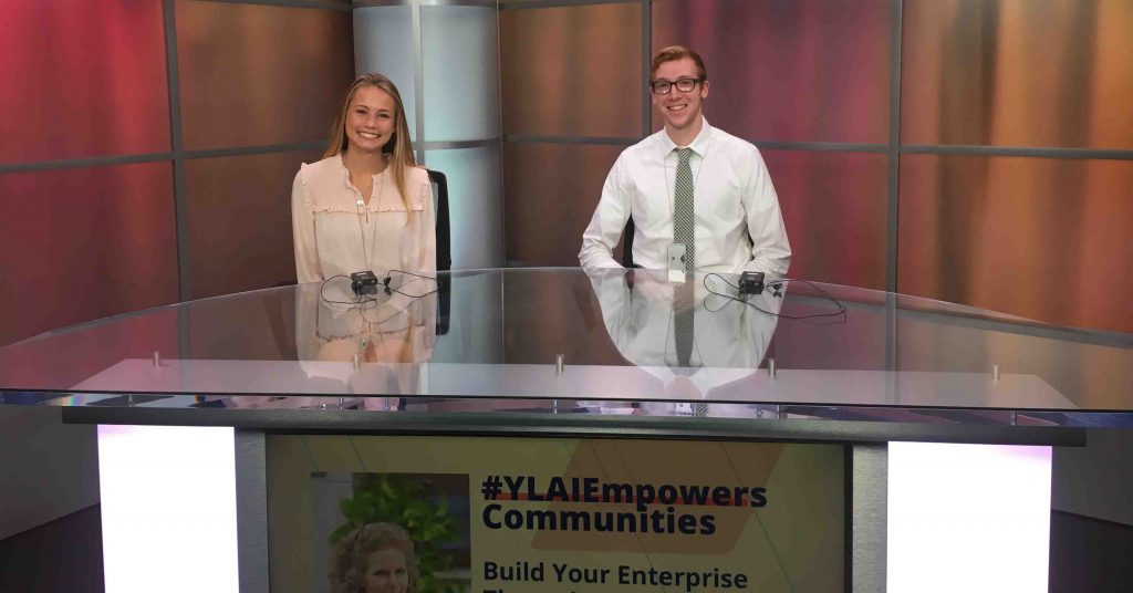 Tyler Hubeny '20 (philosophy and psychology) sits with another student at a TV news anchor desk during his internship in the Sports Diplomacy Division of the Department of State in Washington, D.C.