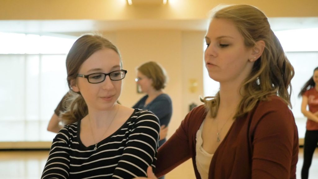Andrea Killian '19 teaches a fellow student to swing dance.