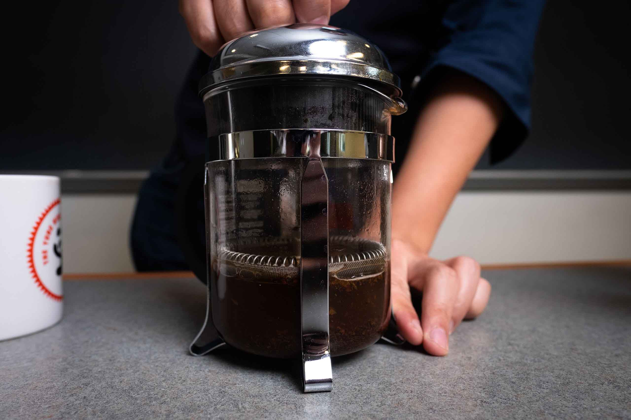 A French press with coffee inside