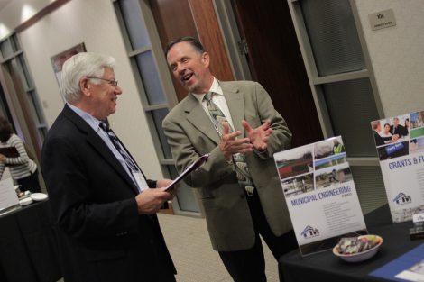 John Kincaid laughs with an attendee at the annual Meyner Center Annual Forum on Local Government.