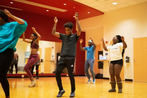 Students dance in a free class at Kirby Sports Center.