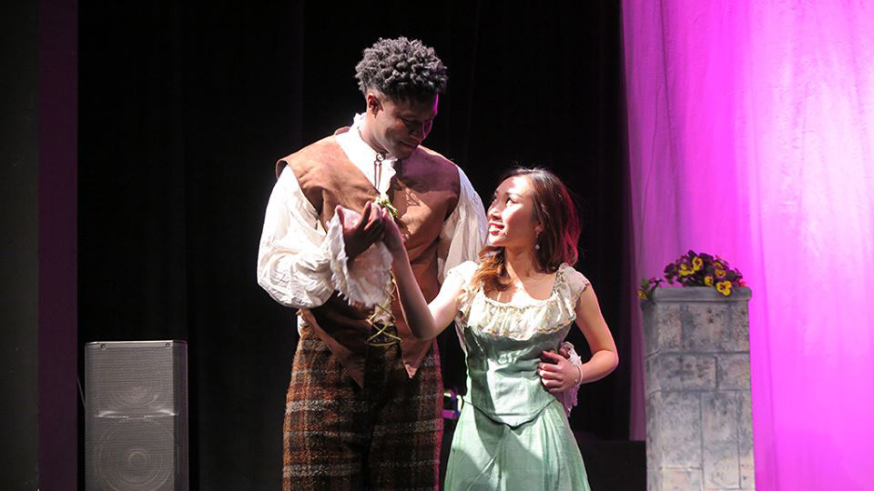 Michael Anekwe performs in a play with a female student.