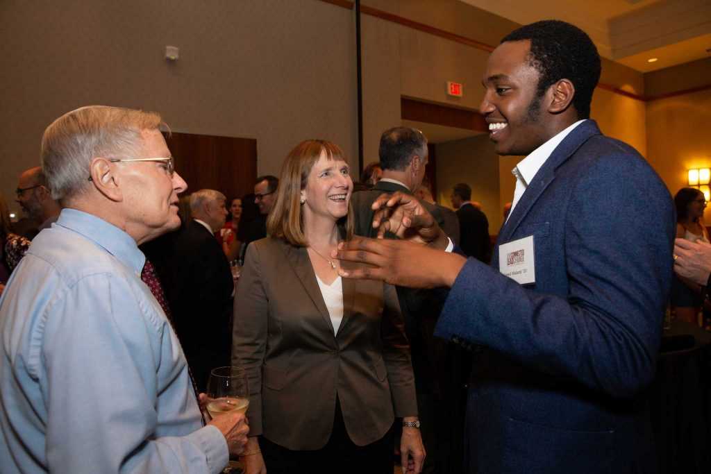 Dave Veshosky, associate professor of civil and environmental engineering, Lafayette President Alison Byerly, and Saeed Malami '20 talk at the reception honoring Bradbury Dyer III '64.