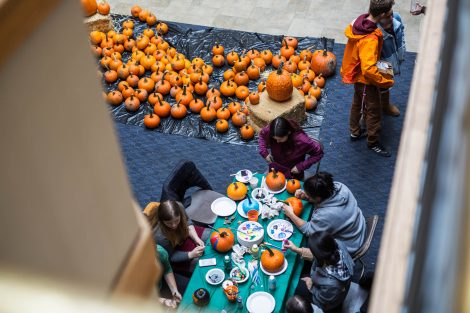 Students paint pumpkins in the Farinon Center during the annual Fall Fest.