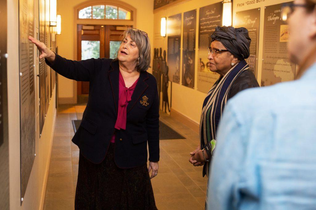 College Archivist Diane Shaw shows Ellen Sirleaf the McDonogh exhibit.