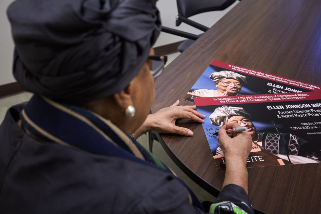Ellen Sirleaf signs a promotional piece for her visit to Lafayette.