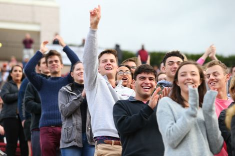 Fans cheer on the football team at Homecoming.