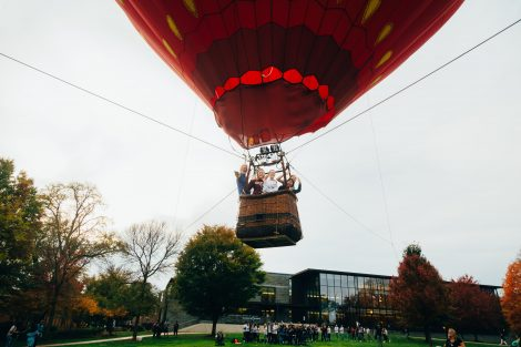 Studens ride in a hot air balloon above the Quad to promote the One Pard initiative