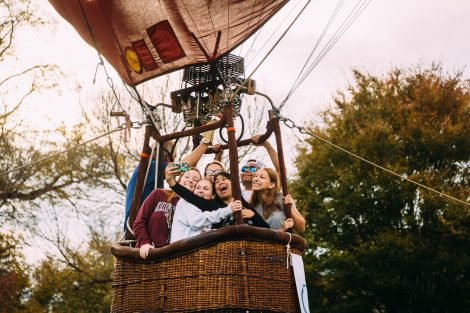 Students ride in a hot air balloon tethered to the Quad.