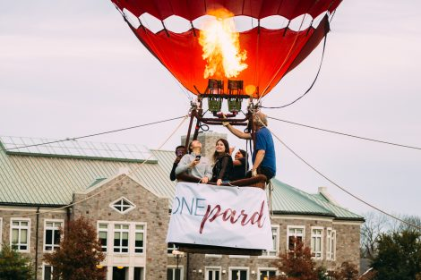 Students ride in a hot air balloon above the Quad to promote the One Pard initiative.
