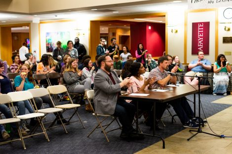 The judges and audience watch the lip sync and air band contest.