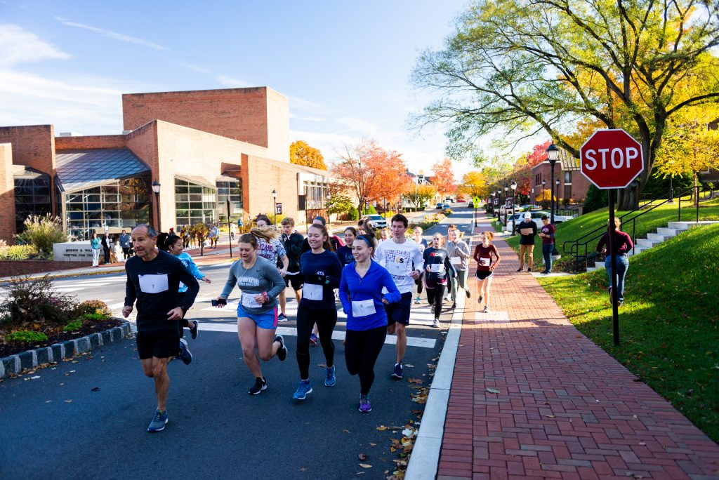 Students run on High Street on campus for the Mental Miles 5K.