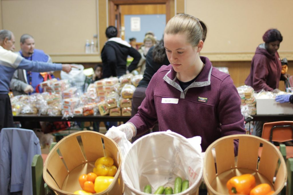Madison Cass '22 gets peppers and other vegetables in place at the St. Vincent De Paul food bank.
