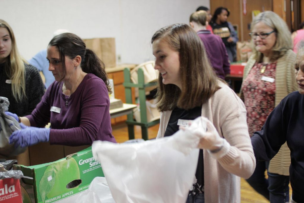 Plastic bag in hand, Liza Makarovo '21 volunteers in the food pantry.