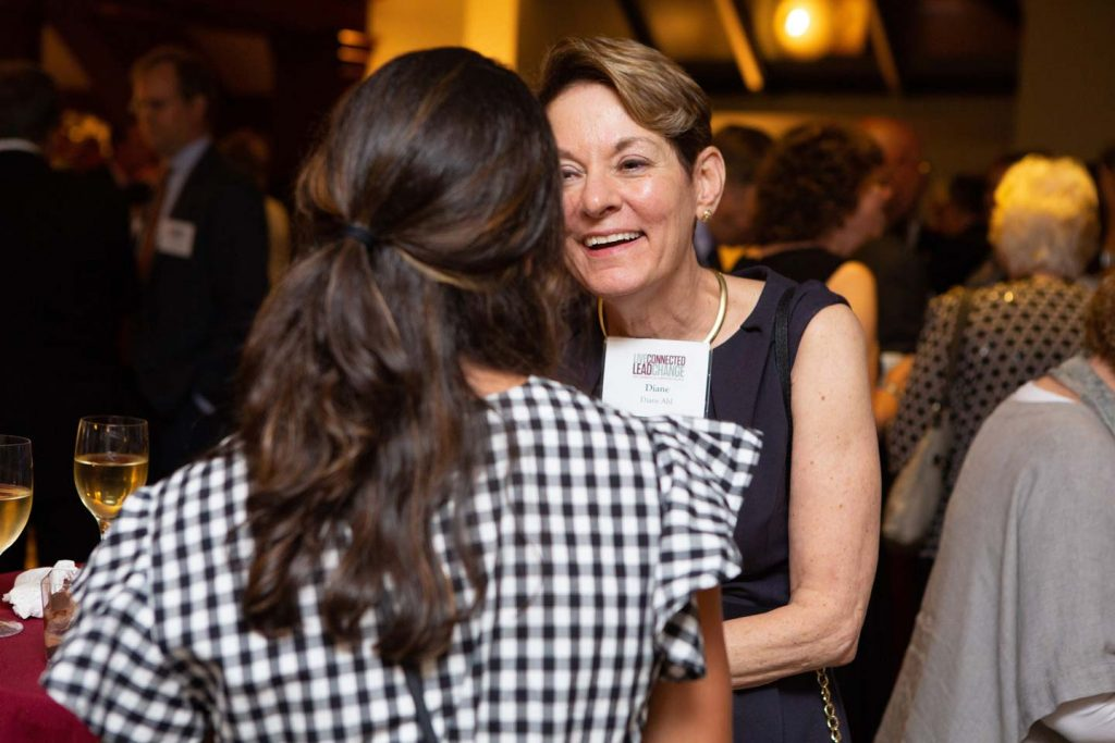 Diane Cole Ahl speaks with someone at an alumni event at the Metropolitan Museum of Art.