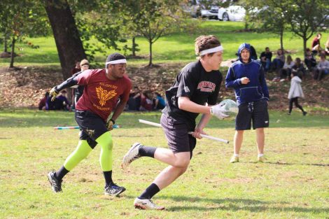 Two Quidditch players compete.