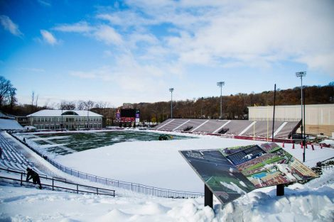 Snow removal takes place at Fisher Stadium.